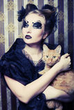Vampire woman with cat Royalty Free Stock Image