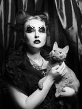 Vampire woman with cat Royalty Free Stock Photography