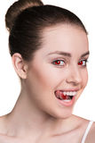 Vampire woman with fangs. Mysterious vampire woman with fangs isolated on white Stock Photo