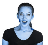 Vampire woman with fangs Stock Photo