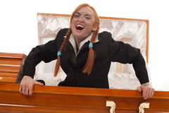 Vampire woman gets up from coffin Stock Images