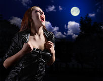 Vampire woman on night background. With moon Stock Photography