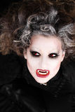 Vampire woman portrait with mouth open showing teeth canines. Halloween make up Stock Photography