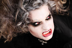 Vampire woman portrait with mouth showing teeth canines, halloween make up Stock Images