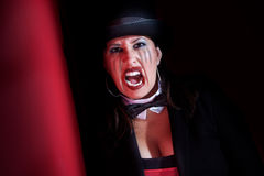 Vampire woman in top hat. Woman dressed like a circus ringmaster Stock Photo