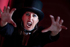 Vampire woman in top hat. Woman dressed like a circus ringmaster Royalty Free Stock Photo