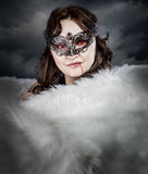 Vampire woman with Venetian mask and white stole Stock Image