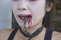 Vampire women with chain in her mouth. royalty free stock photo