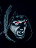 Vampire. Young vampire man shows his tooth Royalty Free Stock Image