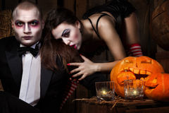 Vampires with halloween pumpkin Royalty Free Stock Photos