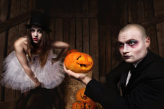 Vampires with halloween pumpkin Stock Image