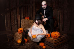 Vampires with halloween pumpkin Royalty Free Stock Images