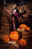 Vampires with halloween pumpkin Royalty Free Stock Image