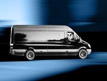 Van. A black van on the way to the customer Stock Images