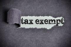 Van belastingen vrijgesteld woord in het kader van gescheurd zwart suikerdocument stock afbeeldingen