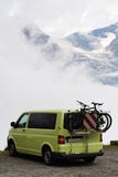 Van and bicycle in mountains Royalty Free Stock Images