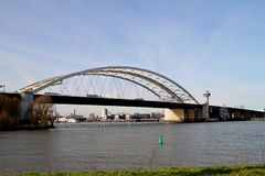 The Van Brienenoordbrug as suspension bridge over the nieuwe maas river on motorway A16 in Rotterdam the Netherlands. The Van Brienenoordbrug as suspension stock image