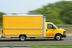 Van/carro amarillos brillantes genéricos Fotos de archivo