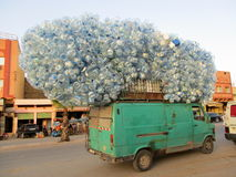 Van carrying empty plastic water bottles Royalty Free Stock Images