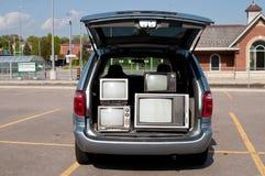 Van com aparelhos de televisão do vintage Foto de Stock Royalty Free