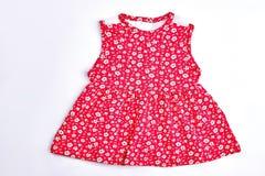 Van de baby-meisje de rode kleding bloemdruk royalty-vrije stock fotografie
