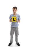 Van de de jongensholding van de tiener de leerlingsplaten van L stock afbeelding