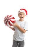 Van de de jongensholding van het kind de snuisterijdecoratie van Kerstmis stock foto's