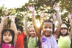 Van de de Kinderjarenpret van kindkinderen Concept van de Activiteitenjonge geitjes het Speelse Stock Foto