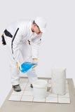 Van de de mengelingstegel van de arbeider de zelfklevende emmer water Stock Foto