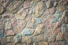 Van de de rotsmuur van de steen de textuurachtergrond Royalty-vrije Stock Foto's