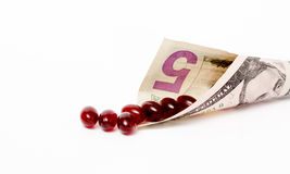Van de dollarrekening en vistraan capsules Royalty-vrije Stock Afbeelding