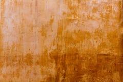 Van de grungeoker van Menorcaciutadella gouden de voorgeveltextuur Stock Afbeeldingen