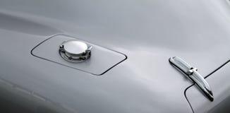 Klassiek GLB van het sportwagengas en boomstam Stock Foto's