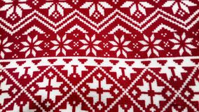 Van de het patroonsneeuw van Norvegiankerstmis de textuur rode achtergrond Stock Foto's