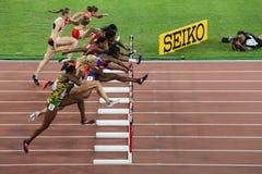 Van de hindernissenmeter def. van vrouwen 100 bij IAAF-Wereldkampioenschappen in Peking, China Stock Fotografie