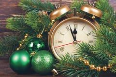 Van de Kerstmisklok en spar takken Stock Foto's