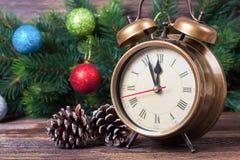 Van de Kerstmisklok en spar takken Stock Fotografie