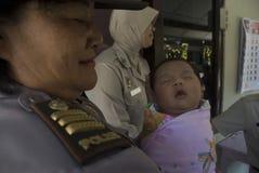 VAN DE KINDERENrechten VAN INDONESIË HET MISBRUIKcomputer-aided software engineering Stock Foto