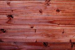 Van de kleuren houten omheining bruin behang als achtergrond Stock Foto's