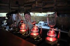Van de de koffiewinkel van koffieinstrumenten Taiwanese coffeetree van de de Wolkenstijl koningskoffie stock foto's