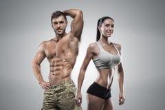 Van de sportenman en vrouw het stellen in studio Stock Foto's