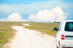 Van on the dirt serpantine road Royalty Free Stock Photography