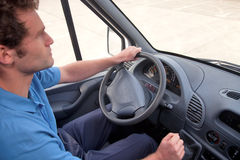 Van driver left hand drive vehicle. Van driver in a left hand drive vehicle. Also available as RHD, instrument panel is correct for both images Stock Photos