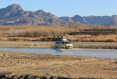 River crossing in southern Afghanistan. A van drives across a river in southern Afghanistan Stock Images
