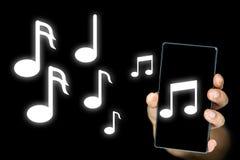 Van een mp3 speler uitgeven of mobiele muzieknota's die royalty-vrije stock foto