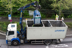 Van emptying glass recycling container Royalty Free Stock Photos