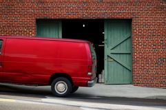 Van in Front of Warehouse Doors Royalty Free Stock Image