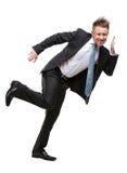 Van gemiddelde lengte van zakenman het plaatsen tegen iets Stock Foto