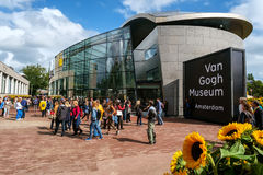 Van Gogh Museum, Amsterdam. Amsterdam, the Netherlands: crowd in front of the new wing of the Van Gogh Museum in Amsterdam with sunflowers in the foreground Stock Photography