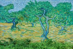 Van Gogh Street Art Olive Trees painted on a brick wall royalty free stock image